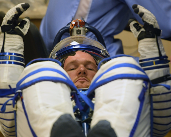 Getting ready for space! Alex's spacesuit is being filled with oxygen